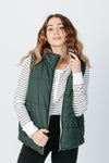 The Wyatt Reversible Vest in Hunter Green, studio shoot; front view