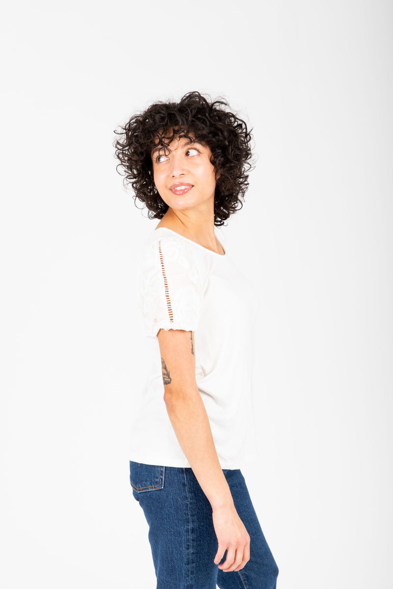 The Mason Floral Lace Sleeve Blouse in White, studio shoot; side view
