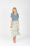 The Louisa Floral Ruffle Skirt in Natural, studio shoot; front view