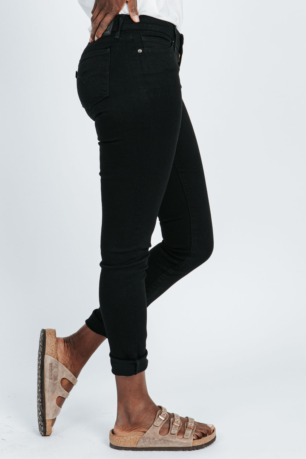 Levi's: 711 Skinny Jeans in Soft Black, studio shoot; side view