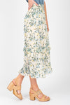 The Louisa Floral Ruffle Skirt in Natural, studio shoot; side view