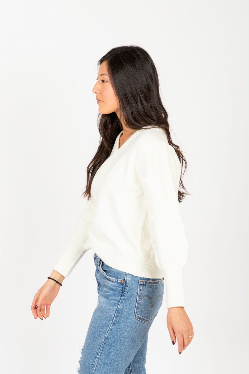 The Truly Pom Knit Sweater in Cream, studio shoot; side view