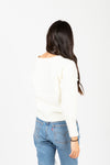 The Truly Pom Knit Sweater in Cream, studio shoot; back view