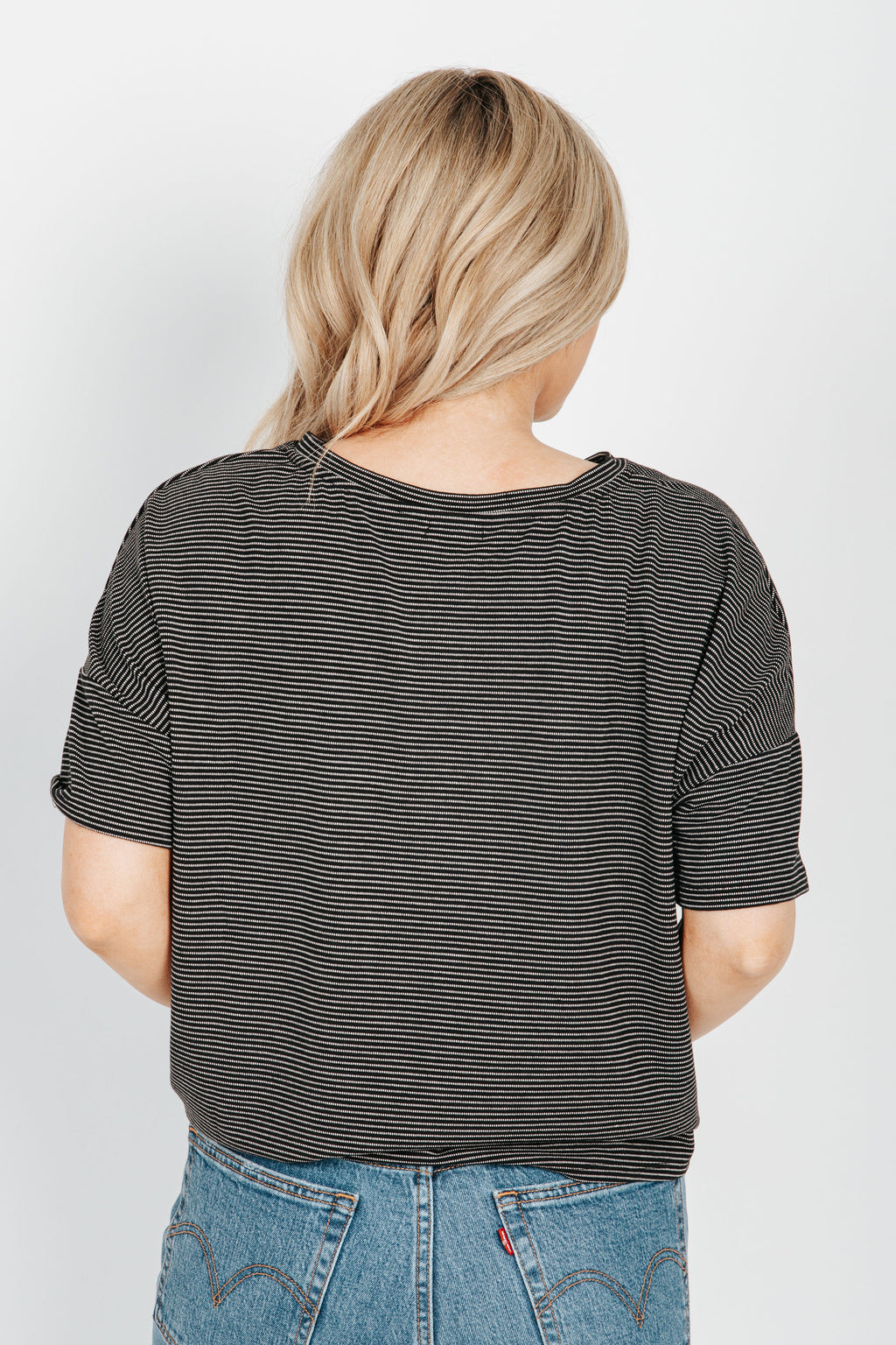 The Peyton Striped Tee in Black, studio shoot; back view