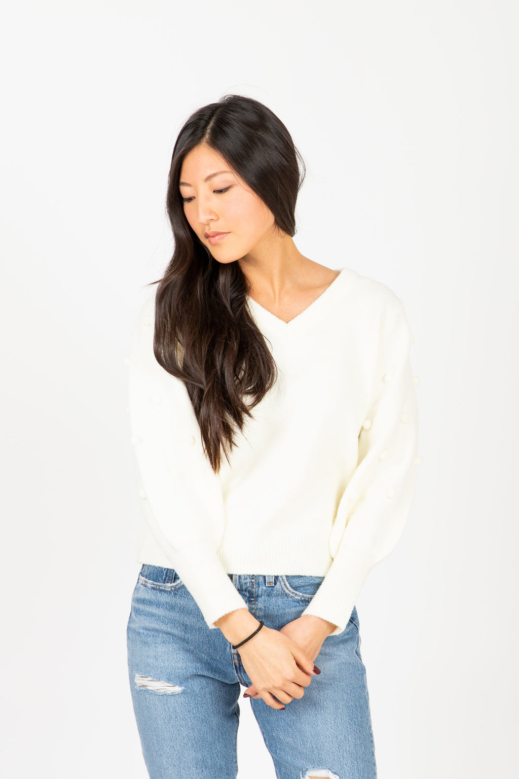 The Truly Pom Knit Sweater in Cream, studio shoot; front view