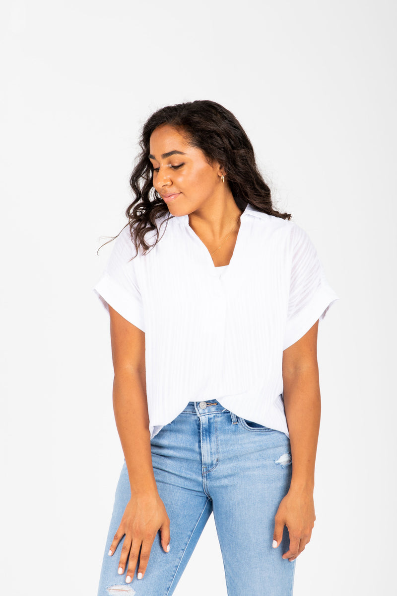 The Nico Collared Popover Blouse in White, studio shoot; front view