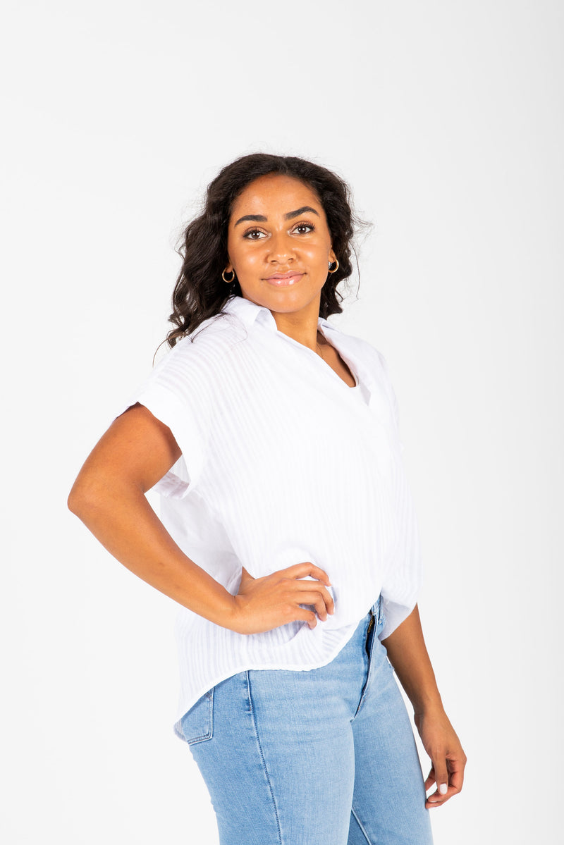 The Nico Collared Popover Blouse in White, studio shoot; side view