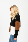 The Outline Block Mock Neck Sweater in Black, studio shoot; side view