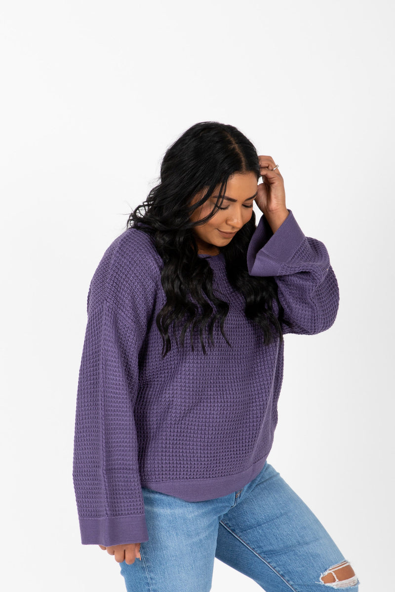 The Ryn Thick Knit Sweater in Midnight, studio shoot; side view