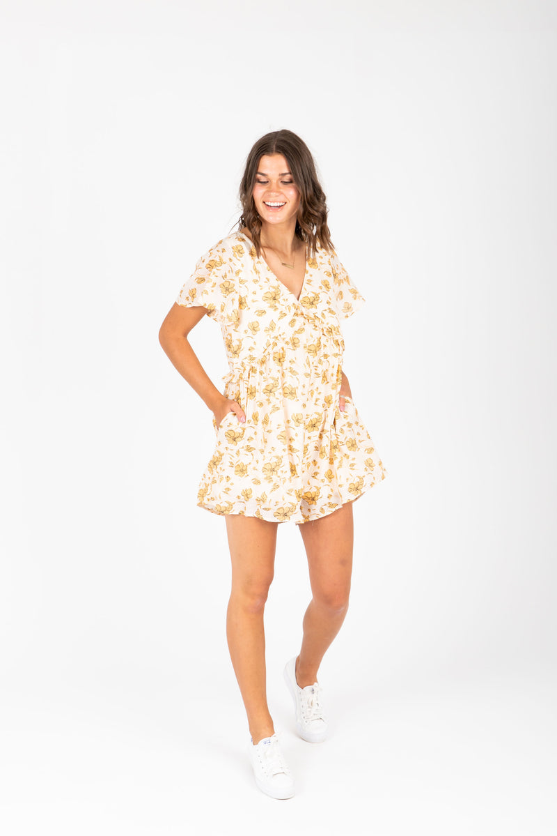 The Alexis Floral Romper in Peach, studio shoot; front view
