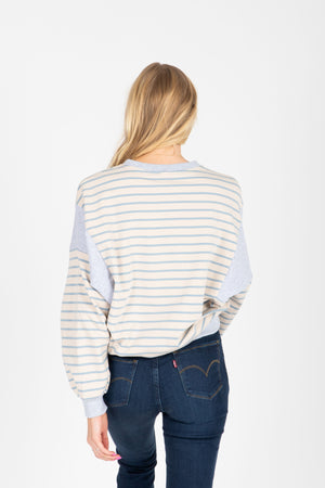 The Vicky Striped Sweatshirt in Sky, studio shoot; back view