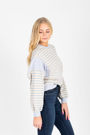 The Vicky Striped Sweatshirt in Sky, studio shoot; side view
