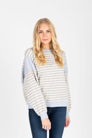 The Vicky Striped Sweatshirt in Sky, studio shoot; front view