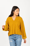 The Chief Slit Sweater in Mustard, studio shoot; front view