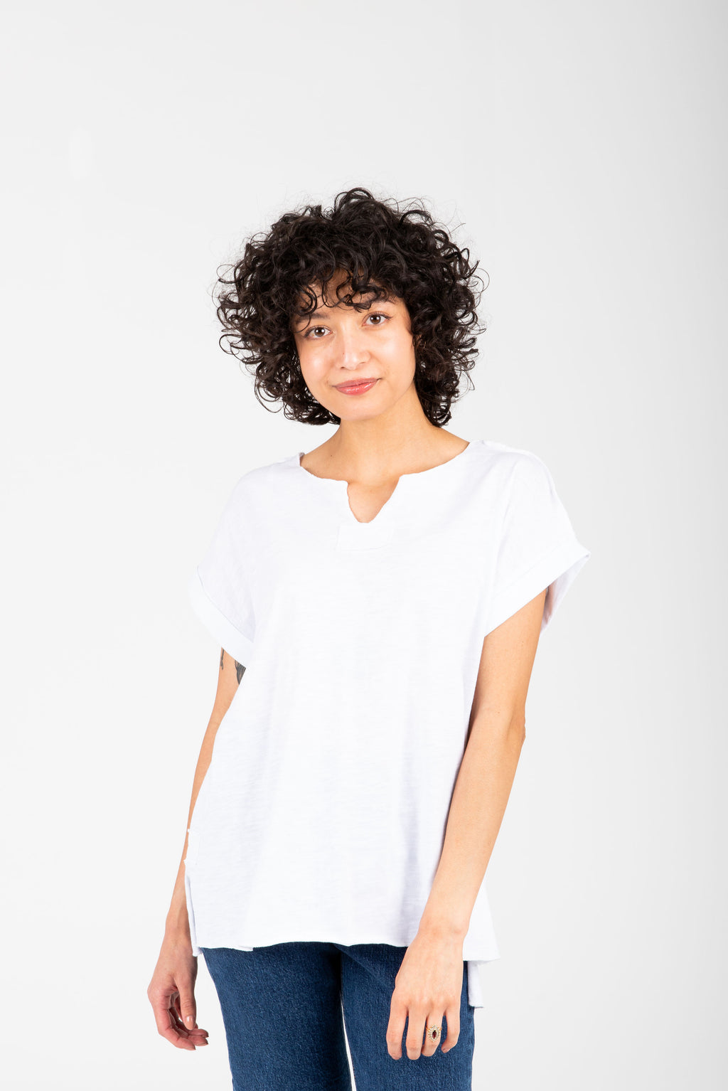 The Abram Casual Slit Blouse in White, studio shoot; front view