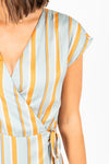 The Heidi Striped Wrap Dress in Aqua, studio shoot; closer up front view