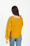 The Chief Slit Sweater in Mustard, studio shoot; back view