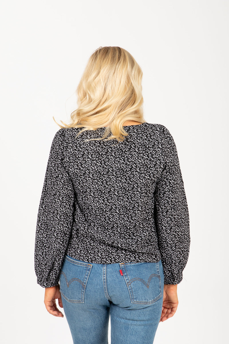 The Select Patterned Blouse in Black, studio shoot; back view
