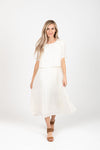 Piper & Scoot: The Hepburn Bib Dress in Ivory, studio shoot; front view