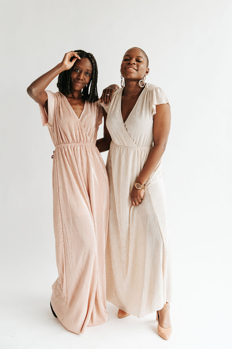 The Stella Shimmer Dress in Blush, studio shoot; front view