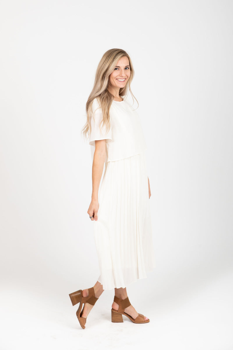 Piper & Scoot: The Hepburn Bib Dress in Ivory, studio shoot; side view