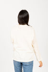 The Coast Easy Mock Neck Tee in Cream, studio shoot; back view