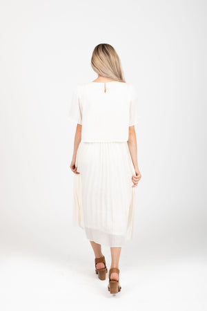 Piper & Scoot: The Hepburn Bib Dress in Ivory, studio shoot; back view