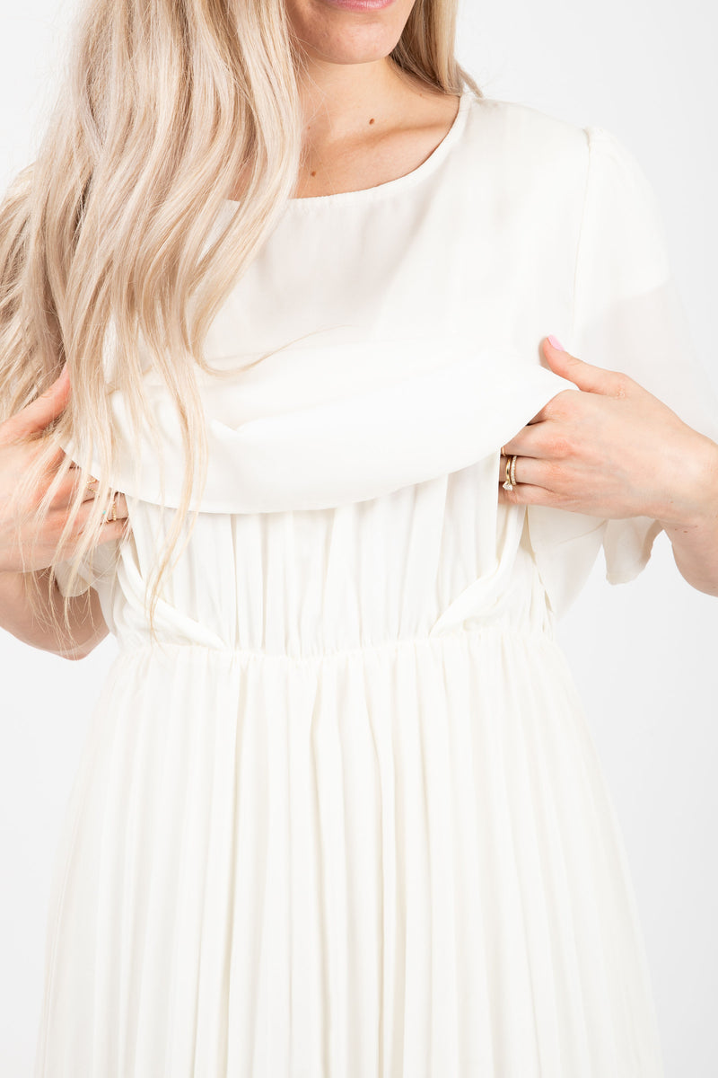 Piper & Scoot: The Hepburn Bib Dress in Ivory, studio shoot; closer up front view