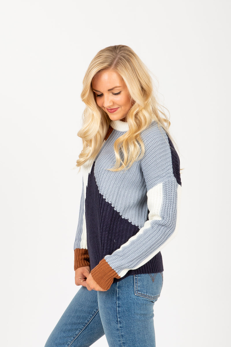 The Trust Angle Block Sweater in Blue Multi, studio shoot; side view