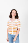 The Omri Striped Button Knit in Mustard, studio shoot; front view