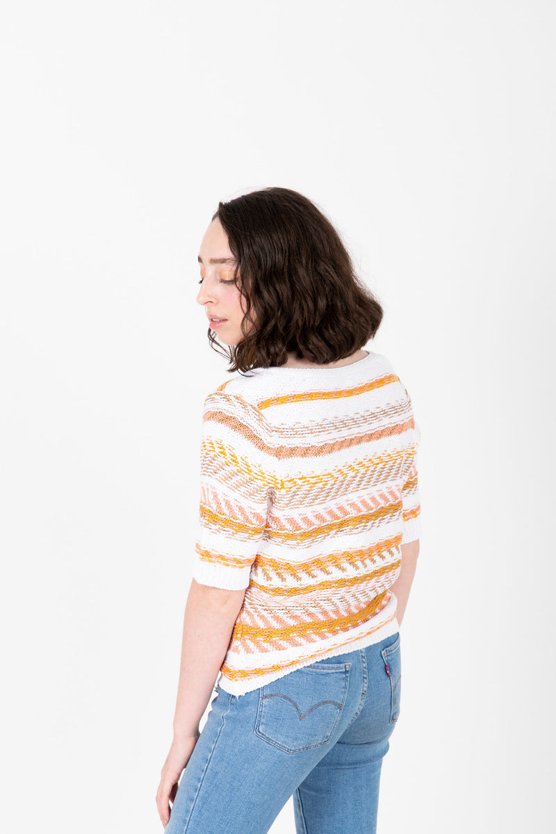 The Omri Striped Button Knit in Mustard, studio shoot; side view