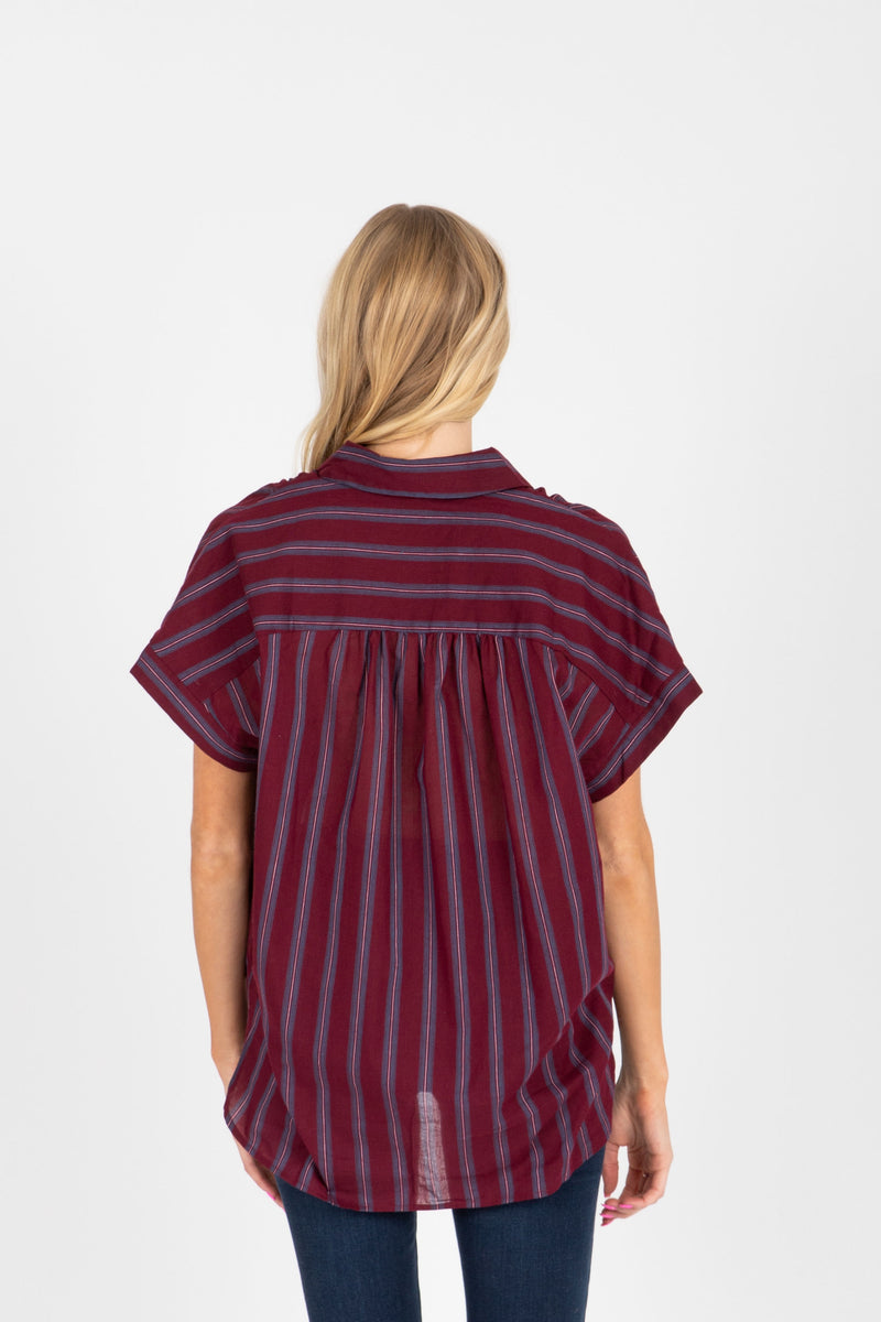 The Amya Striped Button Up Blouse in Plum, studio shoot; back view