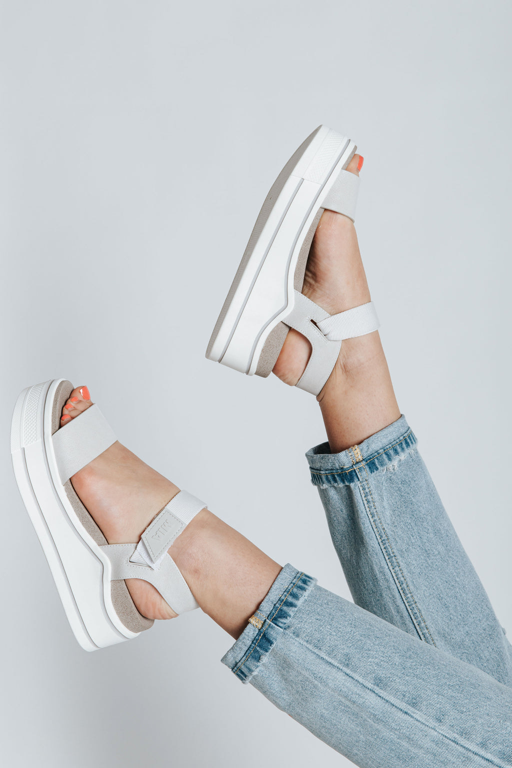 The Odelia Strap Sandal in Off White, studio shoot; side view