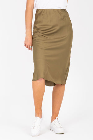 The Esme Satin Midi Skirt in Moss, studio shoot; front view
