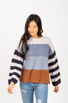 The Rise Striped Contrast Sweater in Navy Multi, studio shoot; front view