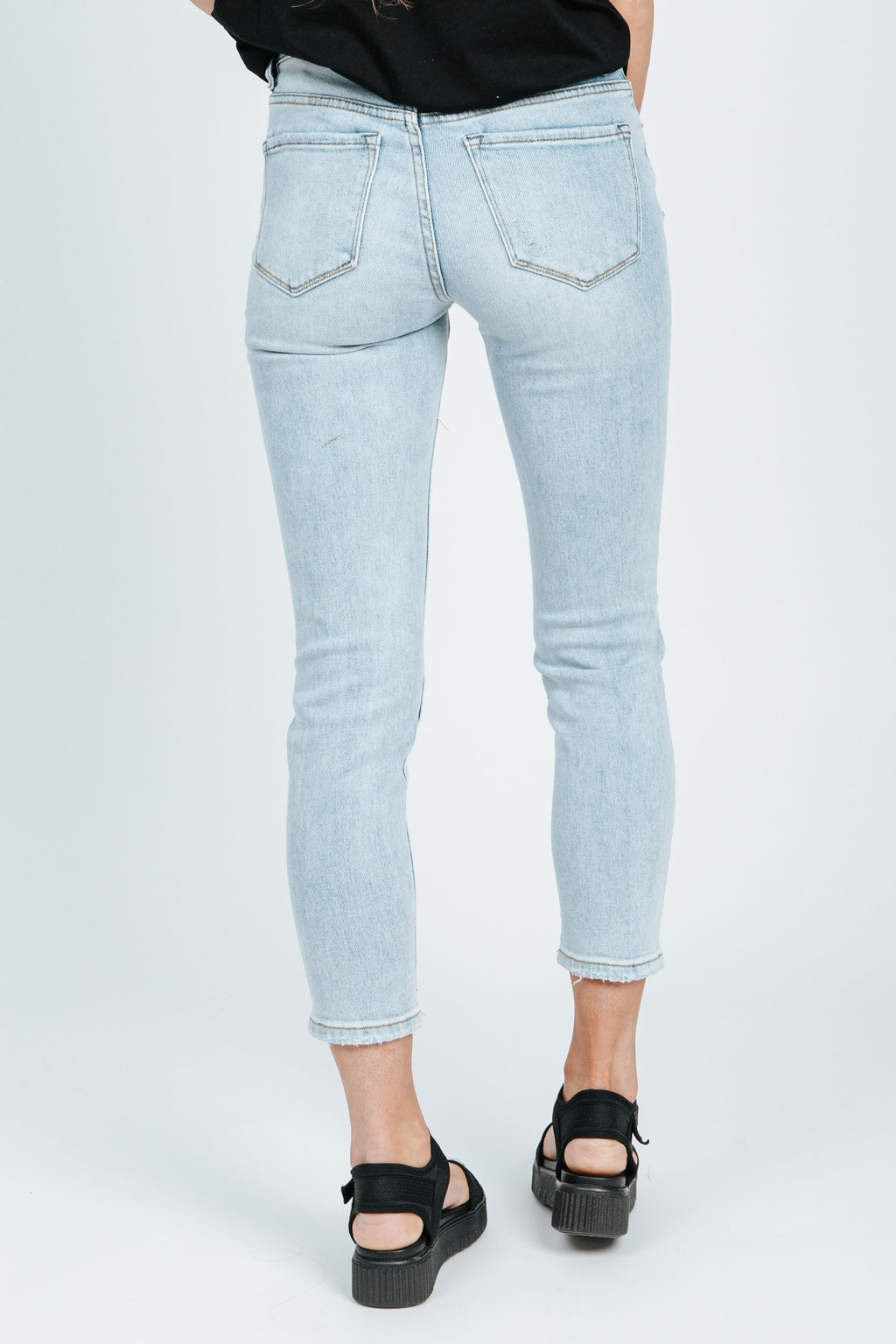 The Delaney Distressed Skinny Jean in Light Wash, studio shoot; back view