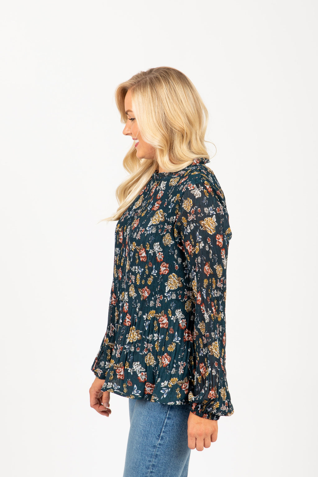 The Shore Floral Pleated Blouse in Teal, studio shoot; side view