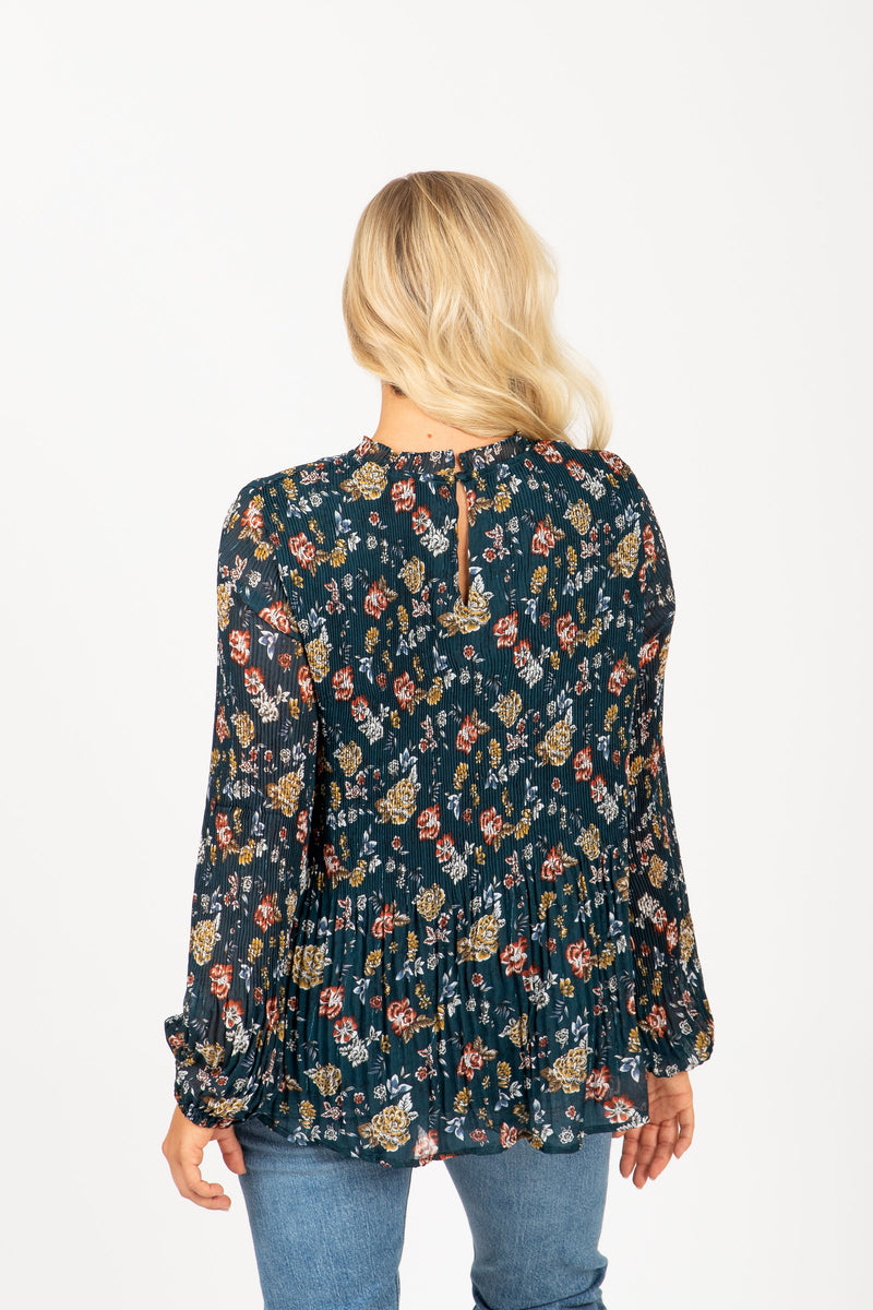 The Shore Floral Pleated Blouse in Teal, studio shoot; back view
