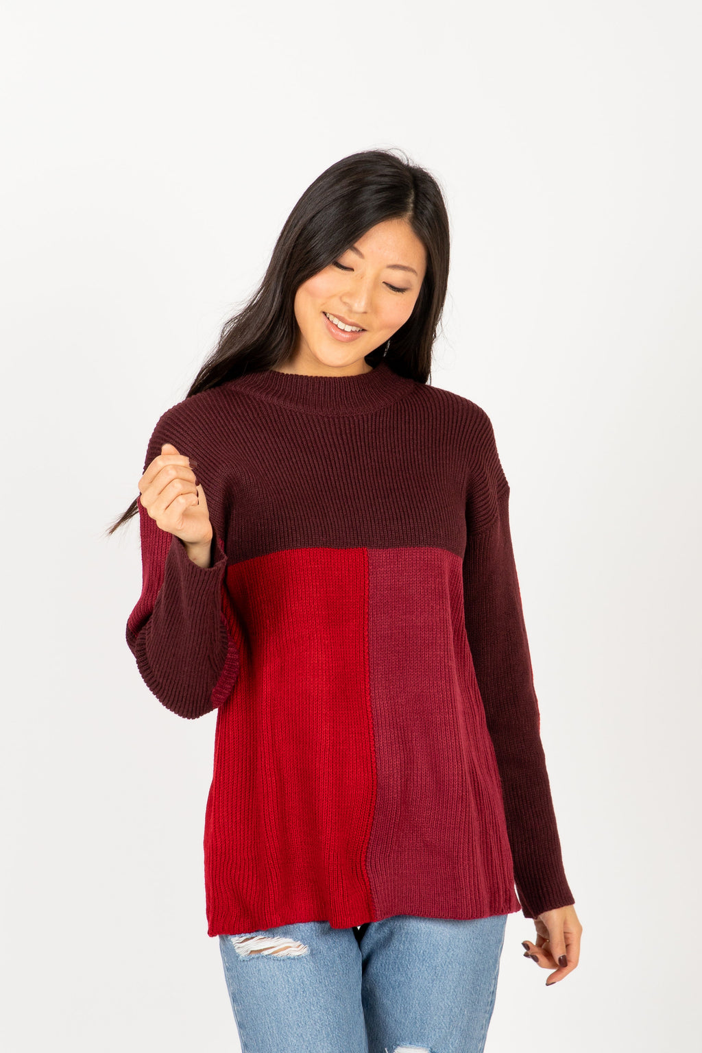 The Point Block Sweater in Burgundy, studio shoot; front view