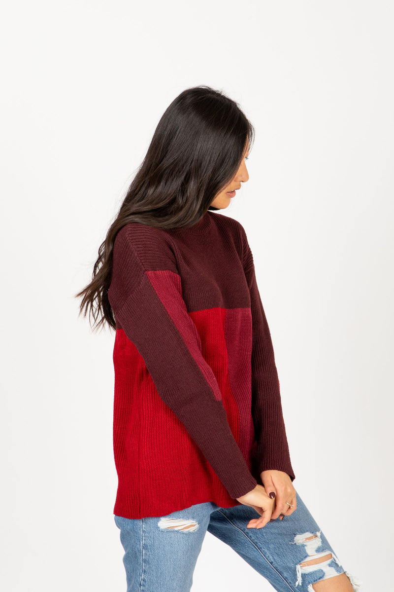 The Point Block Sweater in Burgundy, studio shoot; side view