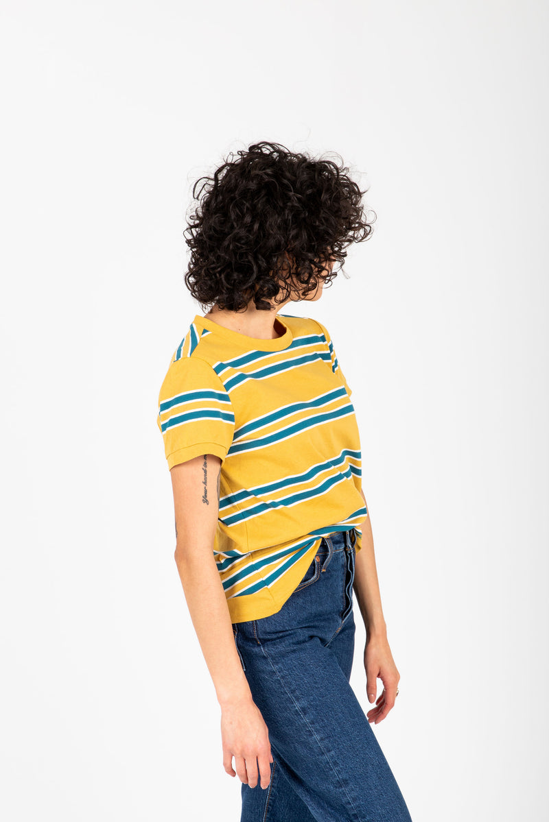 The Luka Striped Tee in Mustard, studio shoot; side view