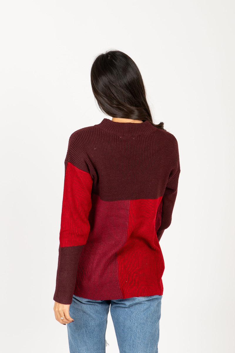 The Point Block Sweater in Burgundy, studio shoot; back view