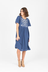 The Megan Embroidered Empire Dress in Carolina Blue