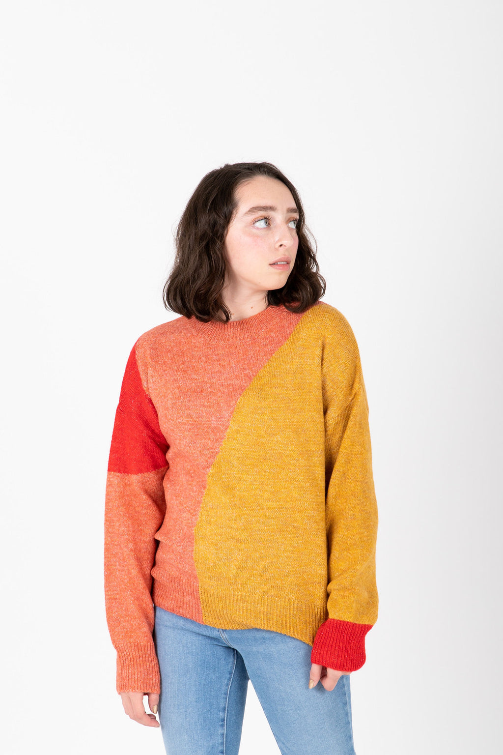 The Siren Colorblock Sweater in Mustard + Pink, studio shoot; front view