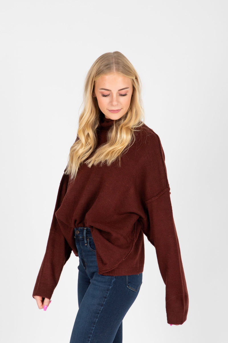The Fay Soft Turtleneck Sweater in Burgundy, studio shoot; side view