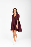 The Davian Tiered Dress in Deep Plum, studio shoot; front view