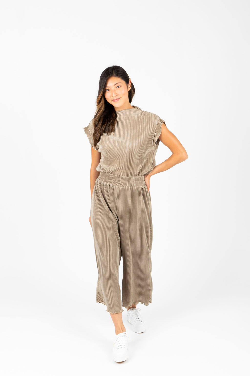 The Ariana Pleated Set in Sage Olive, studio shoot; front view