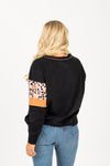 The Skill Animal Print Mix Crew Neck in Black, studio shoot; back view