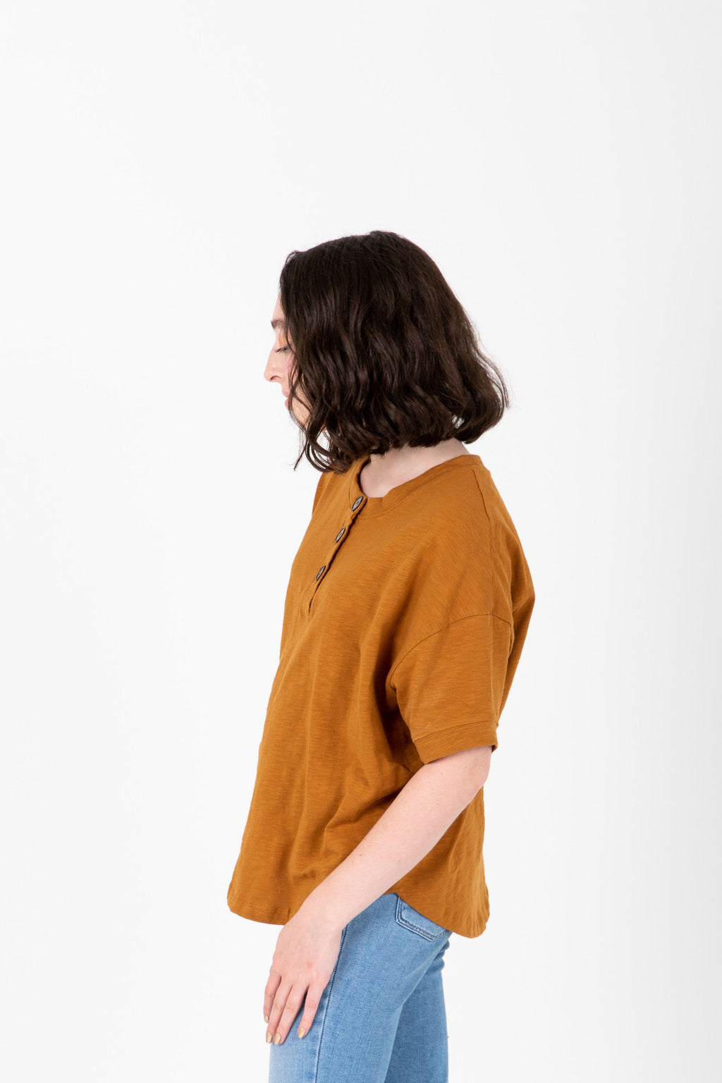 The Eline Casual Button Blouse in Camel, studio shoot; side view