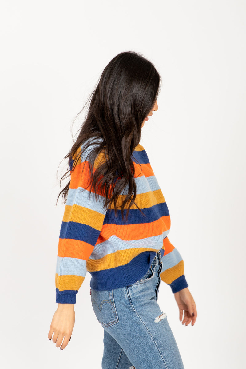 The Cut Striped Sweater in Navy + Rust Multi, studio shoot; side view